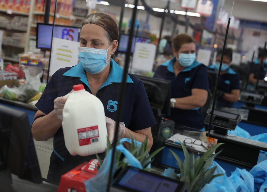 Essential workers keep businesses open and serve customers during COVID-19 pandemic.