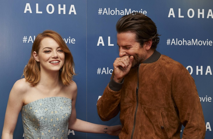 Actors Emma Stone (L) and Bradley Cooper pose at a photocall for their new film release Aloha in London on May 16, 2015.
