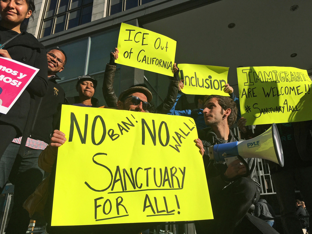 Supporters of California's sanctuary laws rally outside a San Francisco courthouse in 2017.