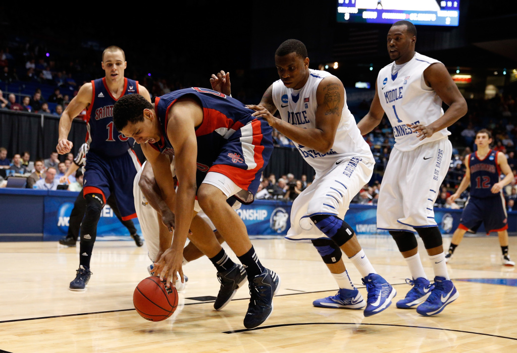 Brad Waldow #00 of the St. Mary's Gaels attempts to control a loose ball in the second half against the Middle Tennessee Blue Raiders during the first round of the 2013 NCAA Men's Basketball Tournament at University of Dayton Arena on March 19, 2013 in Dayton, Ohio.