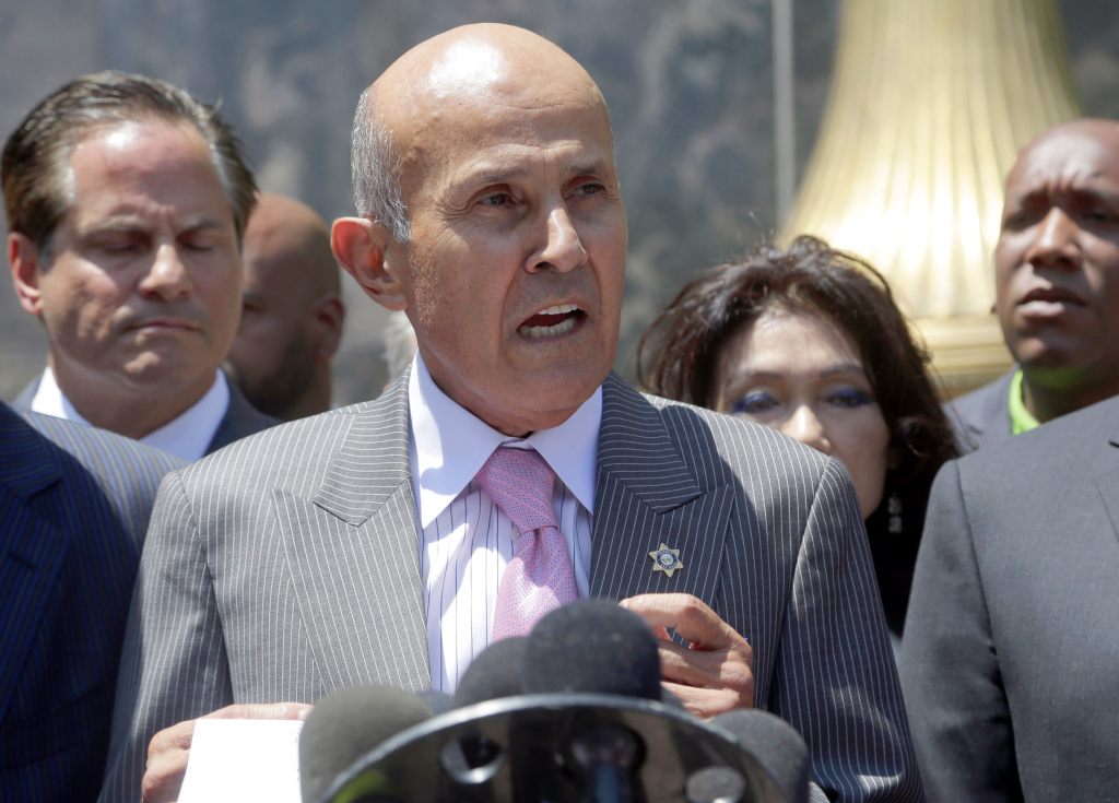 Former Los Angeles County Sheriff Lee Baca speaks to the media after leaving federal court in Los Angeles on Aug. 1, 2016. Baca withdrew a guilty plea and chose to go to trial on a charge of lying to federal authorities in an effort to thwart an FBI investigation into abuses at the jails he ran.