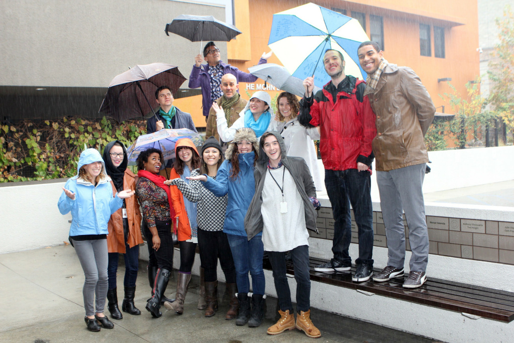 KPCC staffers outside the Mohn Broadcast Center, decked out to face one of the first El Niño storms of the season.