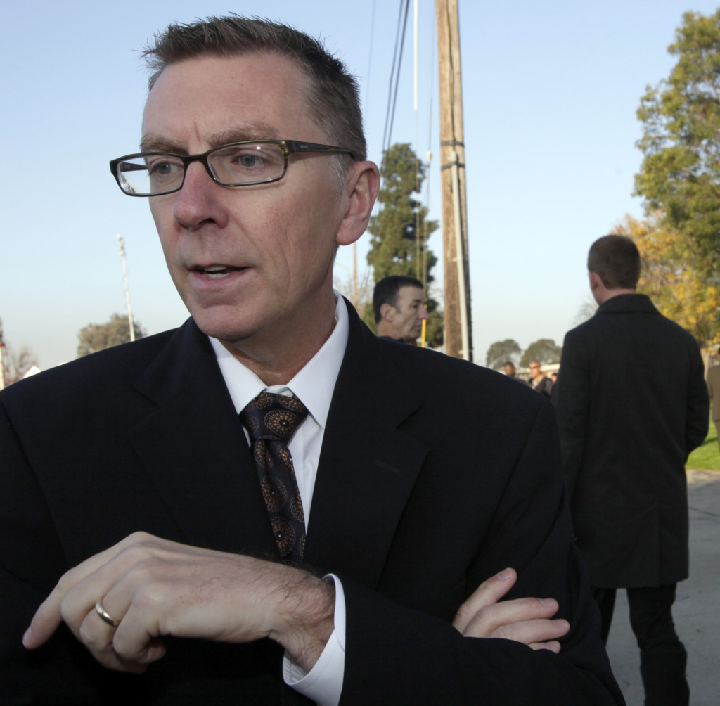 The incoming head of the Los Angeles Unified School District, John Deasy, speaks to the media while students line up for a security check upon their arrival at Gardena High School in Gardena, Calif. on Wednesday, Jan. 19, 2011. The high school where a gun went off in a student's backpack and wounded two classmates failed to use a metal-detector to check youngsters as required, Deasy, said Wednesday. (AP Photo/Nick Ut)