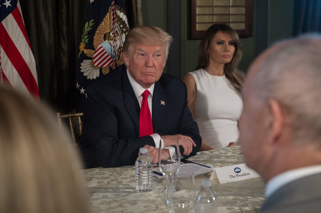 US President Donald Trump listens before a meeting with administration officials and First Lady Melania Trump (R) on the opioid addiction crisis at the Trump National Golf Club in Bedminster, New Jersey, on August 8, 2017. / AFP PHOTO / NICHOLAS KAMM        (Photo credit should read NICHOLAS KAMM/AFP/Getty Images)