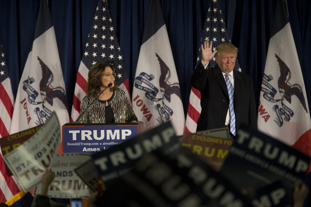 Republican presidential candidate Donald Trump acknowledges the crowd as former Alaska Gov. Sarah Palin speaks at Hansen Agriculture Student Learning Center at Iowa State University on January 19, 2016.