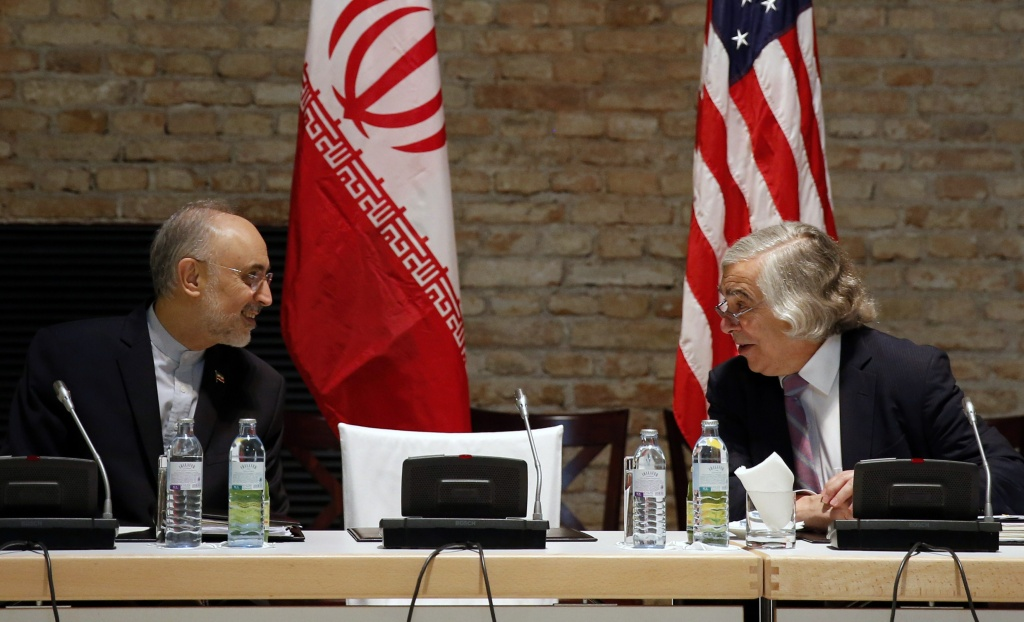 US Secretary of Energy Ernest Moniz (R) and Head of the Iranian Atomic Energy Organization Ali Akbar Salehi (L) meet at a hotel where the Iran nuclear talks meetings are being held in Vienna, Austria, July 9, 2015.