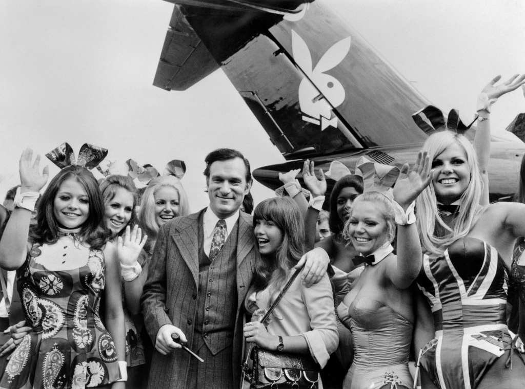 A photo taken on August 30, 1970 shows Playboy publisher Hugh Hefner, his girlfriend actress Barbara Benton and other playmates arriving at Le Bourget airport with the Playboy jet