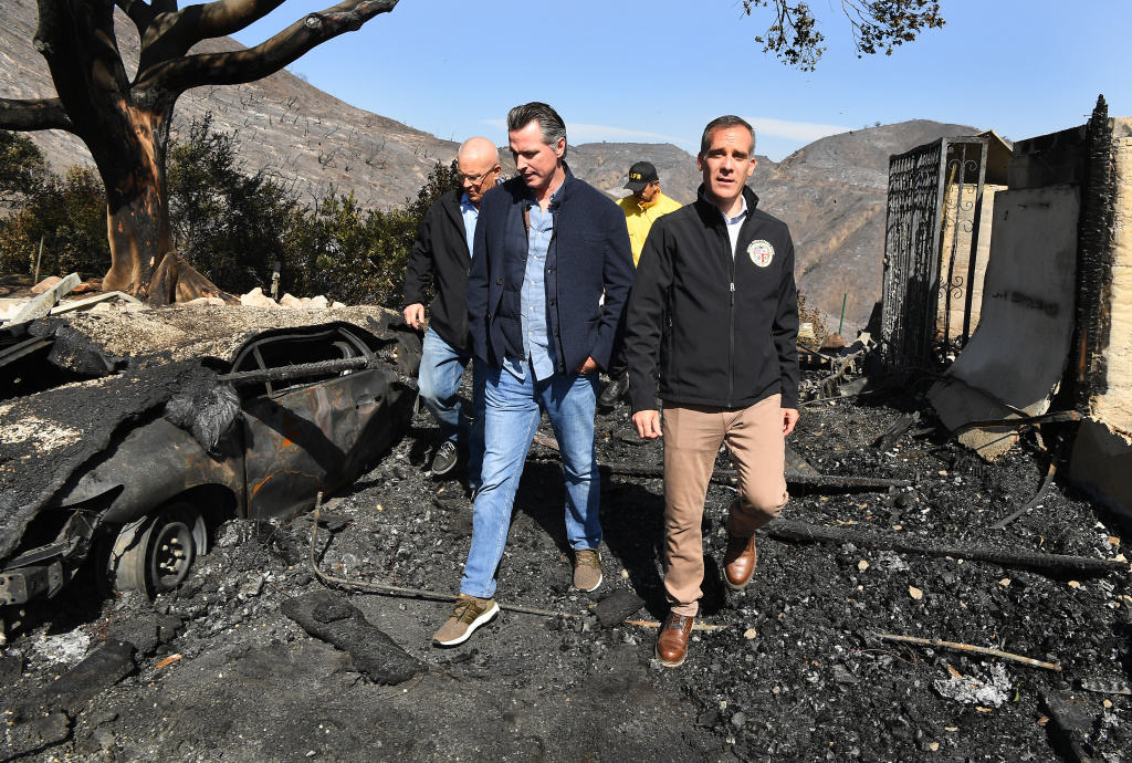 From left, L.A. City Councilman Mike Bonin, California Governor Gavin Newsom and L.A. City Mayor Eric Garcetti tour a burned home along Tigertail Road in Brenwood on October 29, 2019 in Brentwood, California.