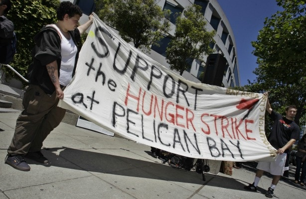 Demonstrators hold up a sign during a rally in front of the State Building in San Francisco on July 1, 2011 to support prisoners at Pelican Bay State Prison.