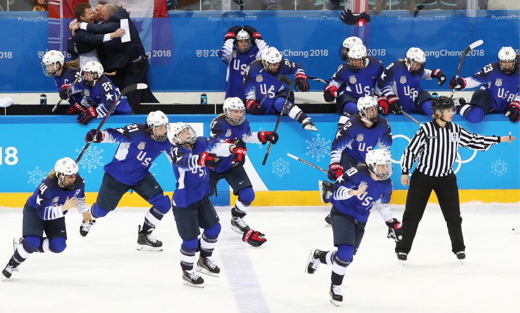 American women's hockey players celebrate winning gold medals in the women's final ice hockey game against Canada at the Gangneung Hockey Center, in the Pyeongchang Winter Olympics.