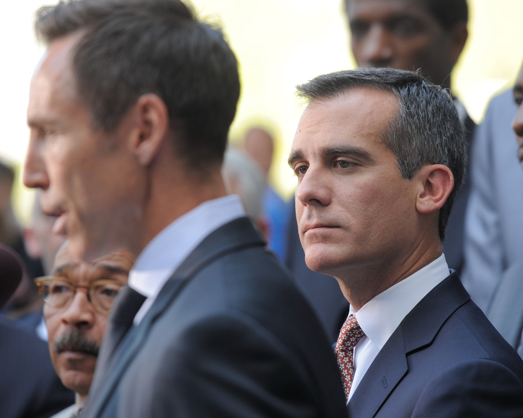 Los Angeles Mayor Eric Garcetti listens to Steve Nash address the media during the press conference in response to the NBA decision on Donald Sterling ownership at Los Angeles City Hall on April 29, 2014 in Los Angeles, California. Silver announced that Sterling will be banned from the NBA for life and will be fined $2.5 million for racist comments released in audio recordings.