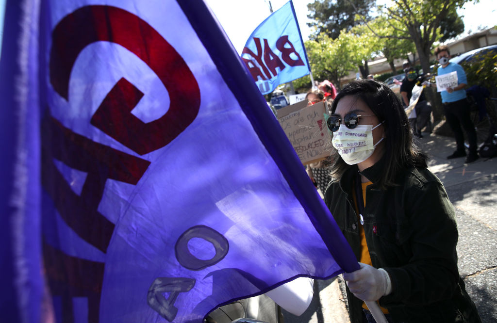 Healthcare workers at Alameda Hospital hold signs as they protest outside of the hospital on April 07, 2020 in Alameda, California.