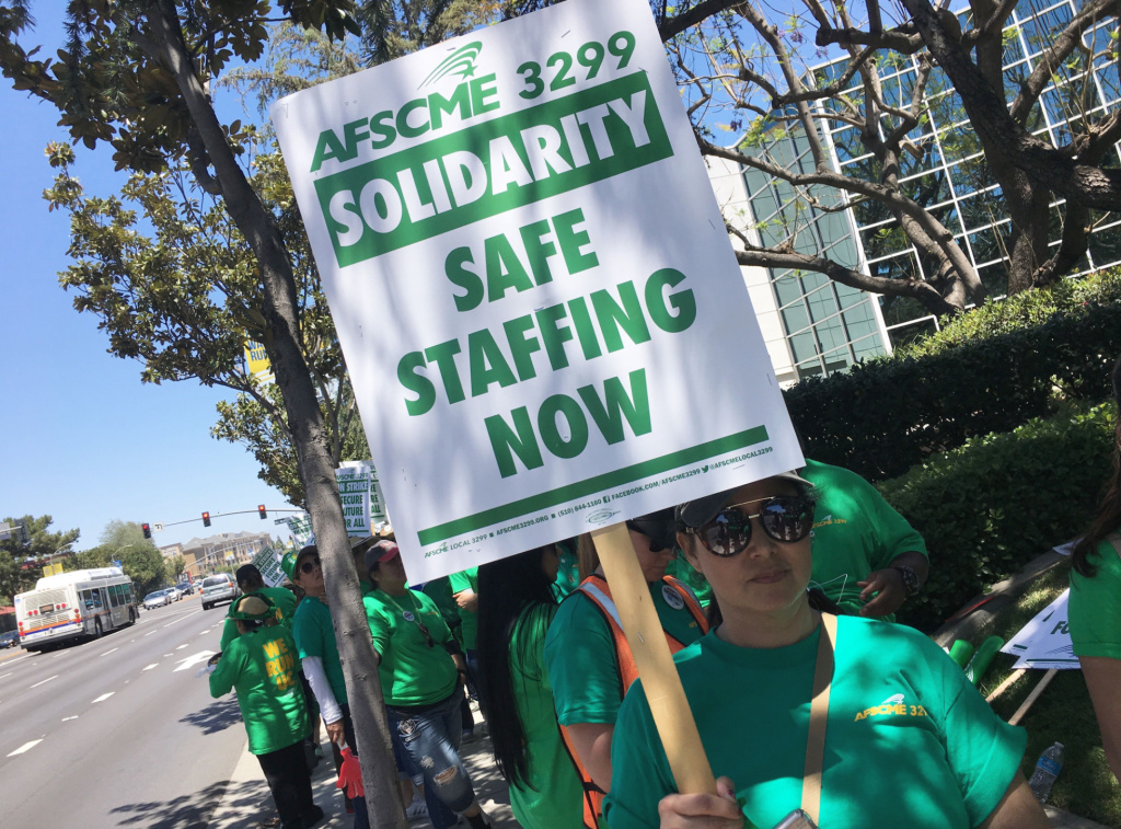 Strikers walk the picket line at UC Irvine Medical Center on the first day of a planned three-day strike by service workers.