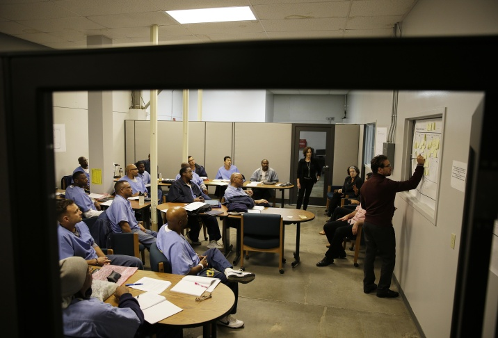In this Nov. 7, 2013, Andrew Kaplan, right, a product marketing manager at Linkedin, leads a session of The Last Mile at San Quentin State Prison in San Quentin, Calif. The Last Mile program trains selected prisoners for eventual employment in a paid internship program within the Silicon Valley technology sector.