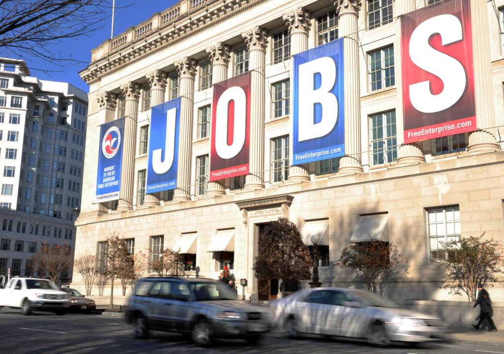 A jobs sign hangs above the entrance to the US Chamber of Commerce building in Washington, DC. The October national payrolls report hits on Friday — that last report from the Labor Department before the election.