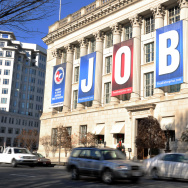 A jobs sign hangs above the entrance to