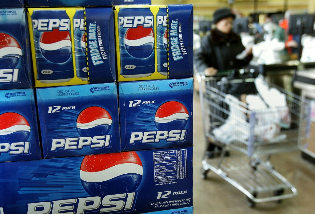 A shopper passes a display of 12-packs of Pepsi at a market March 6, 2006 in Des Plaines, Illinois. Some studies reportedly link sugary sodas and drinks to the obesity epidemic.