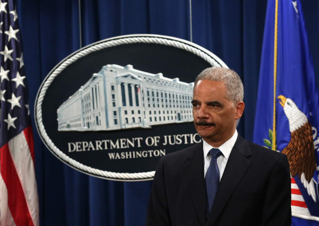 WASHINGTON, DC - MAY 19:  U.S. Attorney General Eric Holder listens during a news conference to announce indictments against Chinese military hackers on cyber-espionage May 19, 2014 at the Department of Justice in Washington, DC. A grand jury in the Western District of Pennsylvania have indicted five Chinese military hackers for computer hacking, economic espionage and other offense directed at six American victim in the U.S. nuclear power, metals and solar products industries.