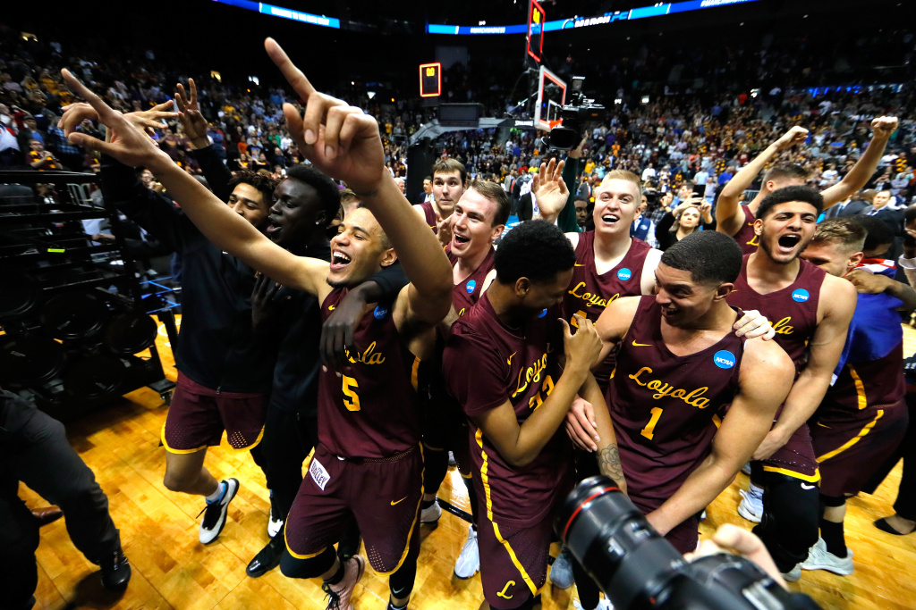 The Loyola Ramblers celebrate after defeating the Kansas State Wildcats during the 2018 NCAA Men's Basketball Tournament South Regional at Philips Arena on March 24, 2018 in Atlanta, Georgia. Loyola defeated Kansas State 78-62 to advance to the Final Four.