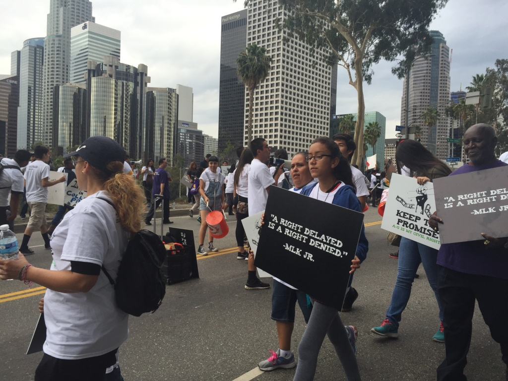 Student, parents and community organizers protest Tuesday outside the Los Angeles Unified board meeting for more resources to help students failing to meeting new graduation requirements.