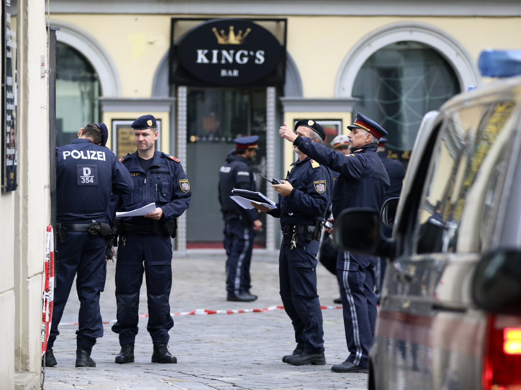 Police officers investigate the scene in Vienna, Austria, Tuesday, the day after at least one gunman went on a shooting spree in the city center before he was shot and killed by police.
