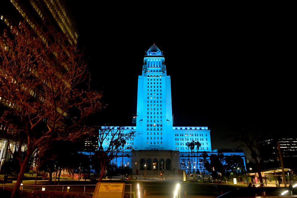 Los Angeles City Hall is lit up in blue to show support for health care workers and first responders on the front lines of the COVID-19 pandemic on April 16, 2020 in Los Angeles, California, United States.