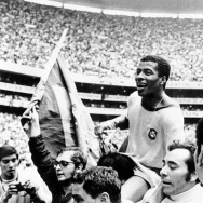 Brazilian forward Jairzinho is carried by fans aft