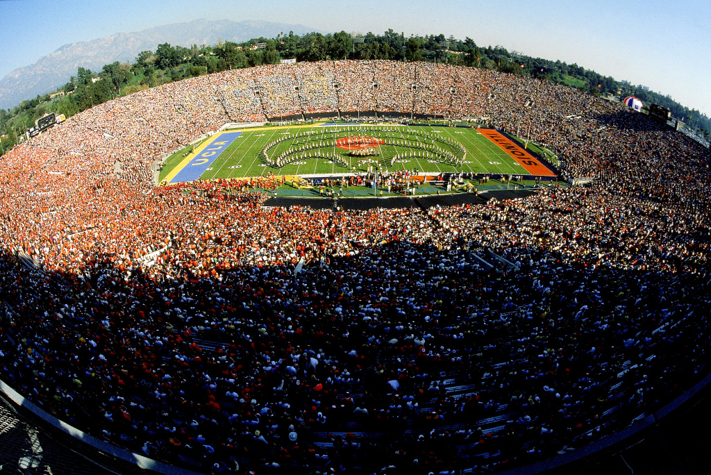 "Fisheye view of the half-time show at the 1984 Rose Bowl Game between UCLA and Illinois, Pasadena, California, January 2, 1984. During the third quarter, Caltech students hacked into the scoreboard so it read ""Caltech 38, MIT 9,"" instead of UCLA leading Illinois by the same number."
