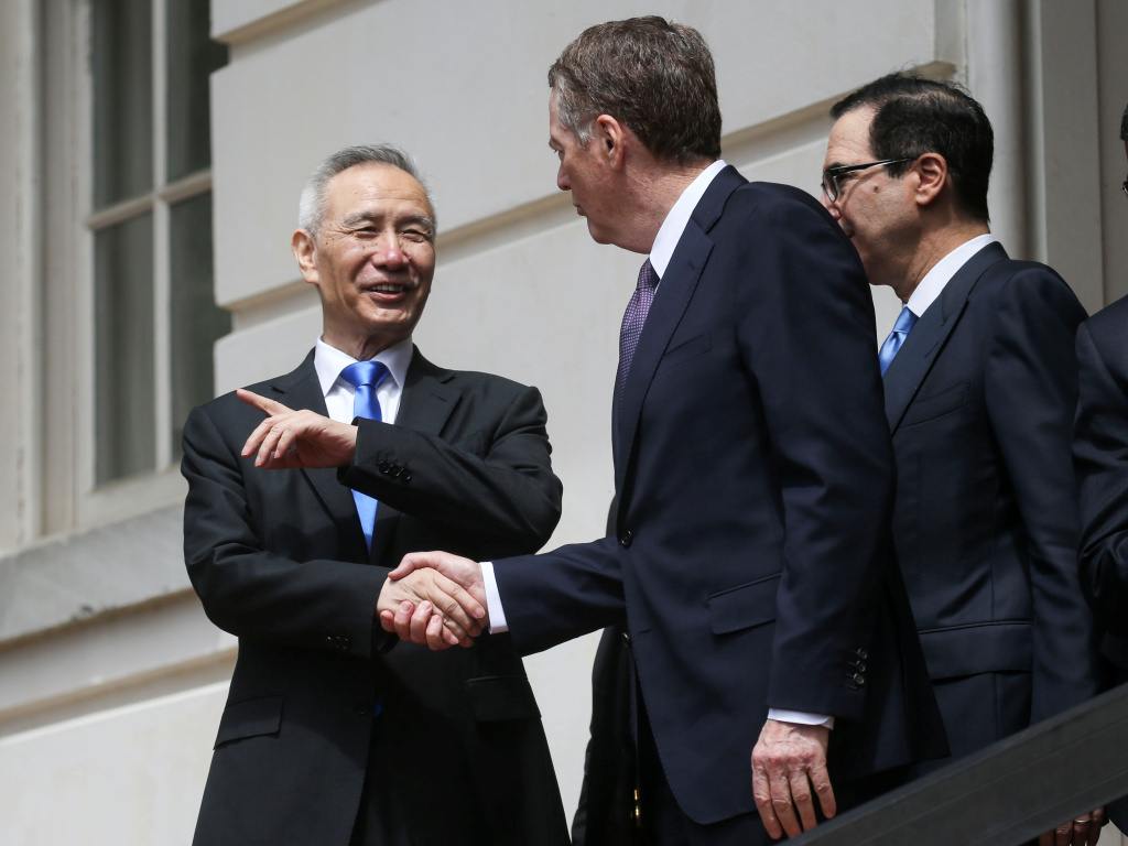 Chinese Vice Premier Liu He talks with U.S. Trade Representative Robert Lighthizer and Treasury Secretary Steven Mnuchin as he departs a round of trade talks in Washington on Friday.