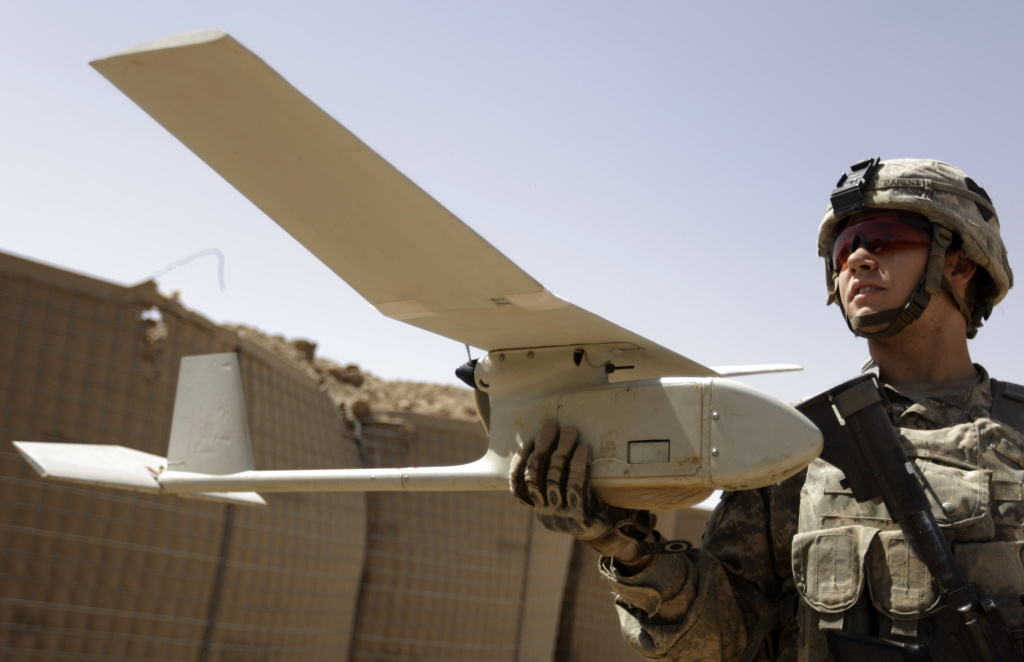 A US army soldier with the 101st Airborne Division Alpha Battery 1-320th prepares to launch a drone outside Combat Outpost Nolen in the village of Jellawar in The Arghandab Valley on September 4, 2010.