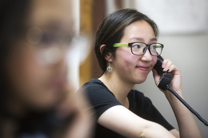 Yvonne Cui, a senior at San Gabriel High School, makes a call in Mandarin during a phone bank shift reminding people to vote in the upcoming primary election at the Asian Americans Advancing Justice Los Angeles on Monday evening, May 23, 2016. The center makes phone bank calls in 10 different languages.