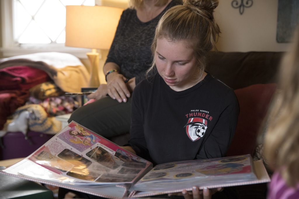 Amber Patterson looks at family photo albums at home in Lomita, California, on Oct. 30, 2017. Lisa Patterson was killed during the Oct. 1 attack in Las Vegas.