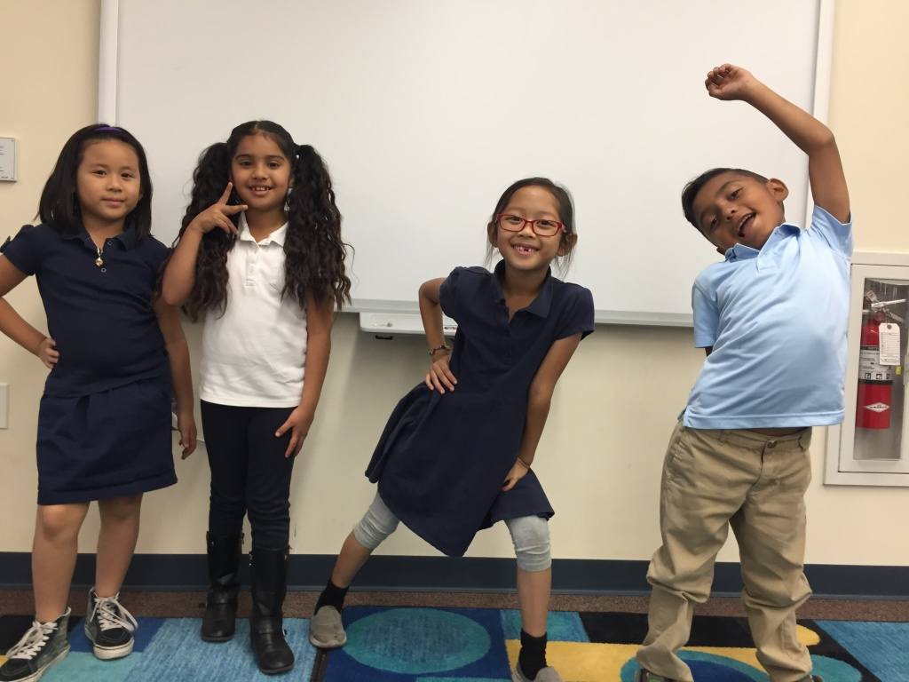 Maxwell Elementary second graders Tiffany Tran, Abigail Estrada, Ava Cassandra Azradon, and Jonathan Guerrero strike a pose after dance class.