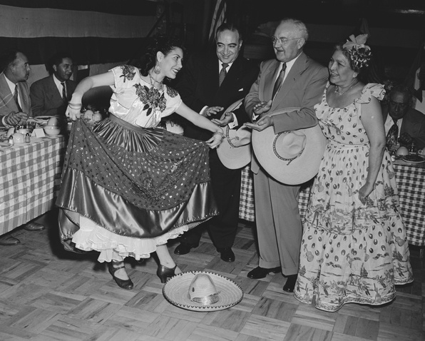 Los Angeles Mayor Fletcher Bowron celebrates Cinco de Mayo with Consuelo de Bonzo and Mexican American dancers on Olvera street. *Photographed left to right are: Velia Valle, Salvadas Dukhart, Mayor Bowron, and Consuelo de Bonzo.