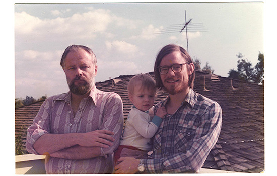 Novelist Phillip K. Dick (L) with writer Paul Williams, founder of 'Crawdaddy!' Williams is holding Dick's young son.