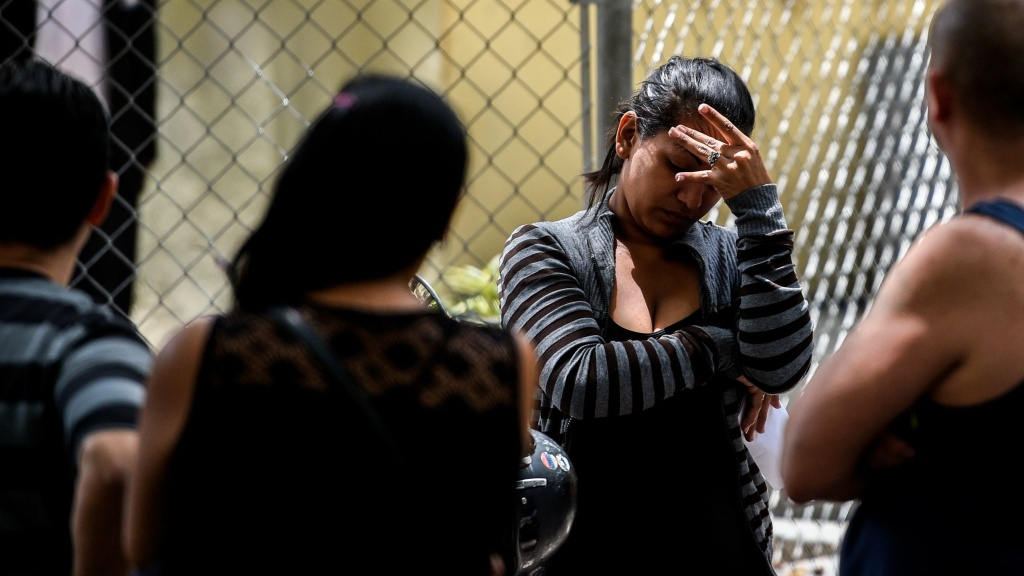 A relative of one of the victims of the nightclub waits outside the morgue in Caracas on Saturday.
