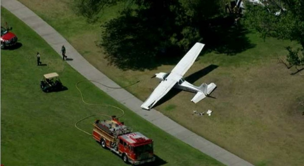 A single-engine Cessna lands at Westlake Golf Course on Monday, April 29, 2013.