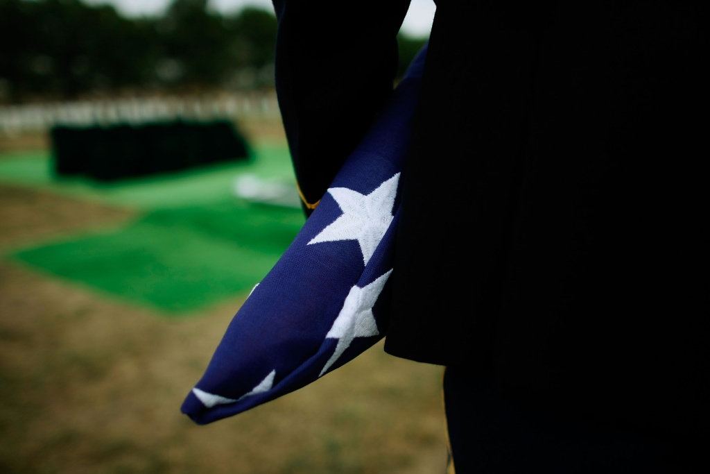 A member of the Honor Guard holds a folded American flag in Arlington, Virginia.