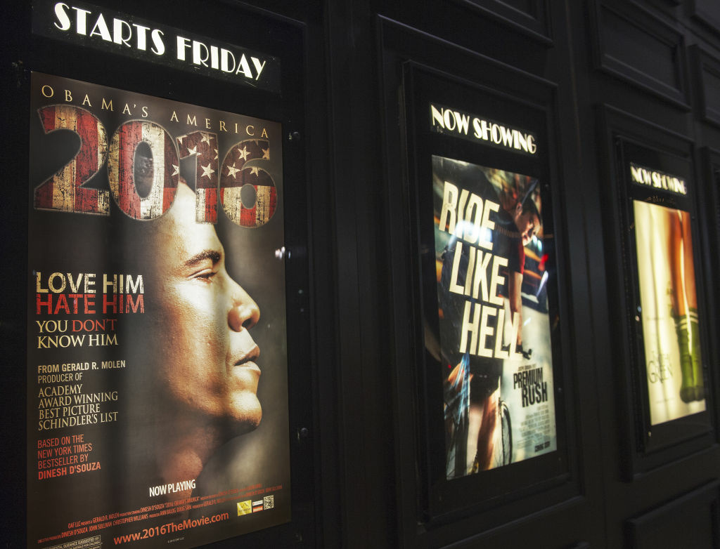 A promotional poster is seen at the Rave Fairfax Corner movie theater in Fairfax, Virginia announcing the new movie '2016: Obama's America' that opened in theaters across the US, August 24, 2012.
