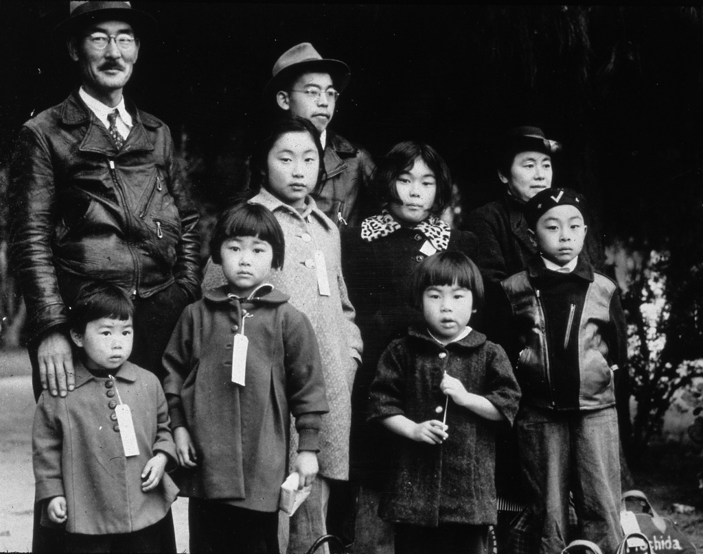 Members of the Japanese-American Mochida family awaiting re-location to a camp, Hayward, California.