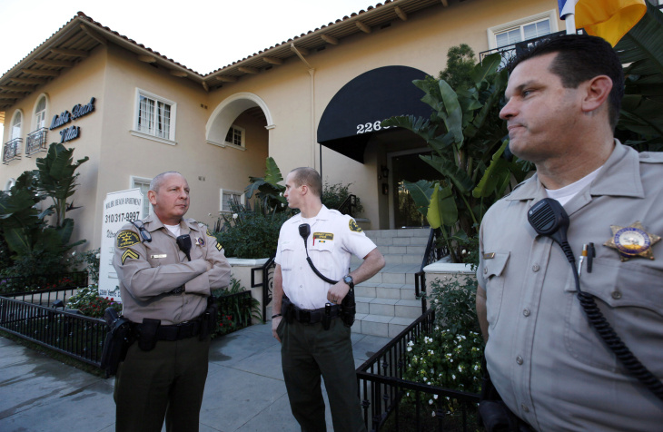 Los Angeles County Sheriff's officers stand outside an apartment building where Scott Sterling,  the son of the  Los Angeles Clippers owner Donald Sterling, lived in Malibu on Wednesday, Jan.2,2012. Scott Sterling was found dead of an apparent drug overdose at his Malibu home, authorities said.