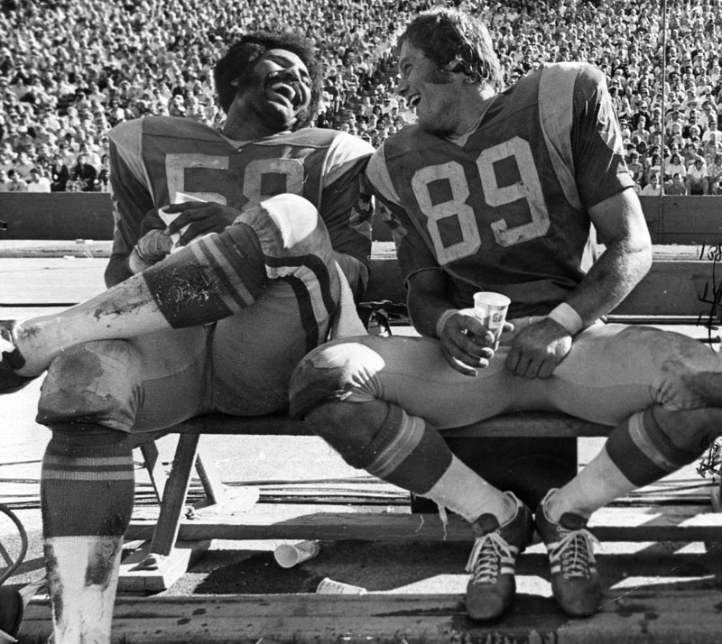 Demonstrating happiness, LA Rams Isiah Robertson and Fred Dryer laugh it up on the sidelines on October 21, 1973.