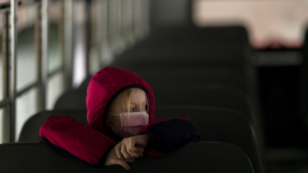 A first-grade student sits on the bus after a day of classes in Woodland, Wash., on Thursday.