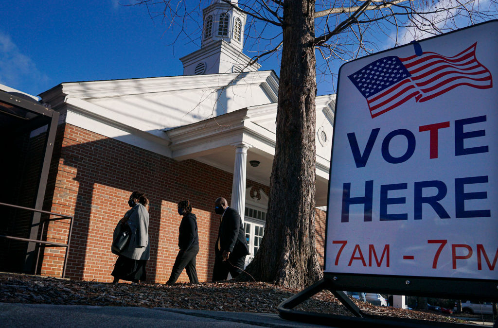 Voters enter a polling station at the Zion Baptist Church on January 5, 2021 in Marietta, Georgia.