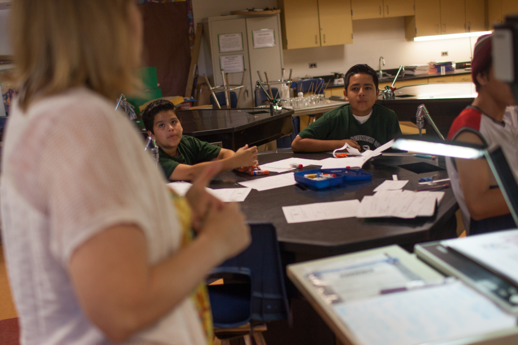 Jennifer Garcia, a substitute teacher for the Long Beach Unified School District, instructs a team of mock investigators at the camp sponsored by Cal State University - Long Beach.