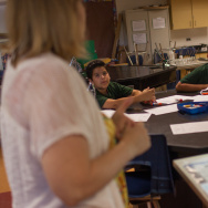 File: Jennifer Garcia, a substitute teacher for the Long Beach Unified School District, instructs a team of mock investigators at a science camp sponsored by Cal State University, Long Beach, in July 2013.