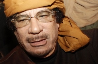 Moammar Gadhafi arrives at the Rixos hotel in the capital Tripoli on March 8, 2011. The Libyan leader has been low-hanging fruit for comedians, with his outlandish dress and outsized personality.