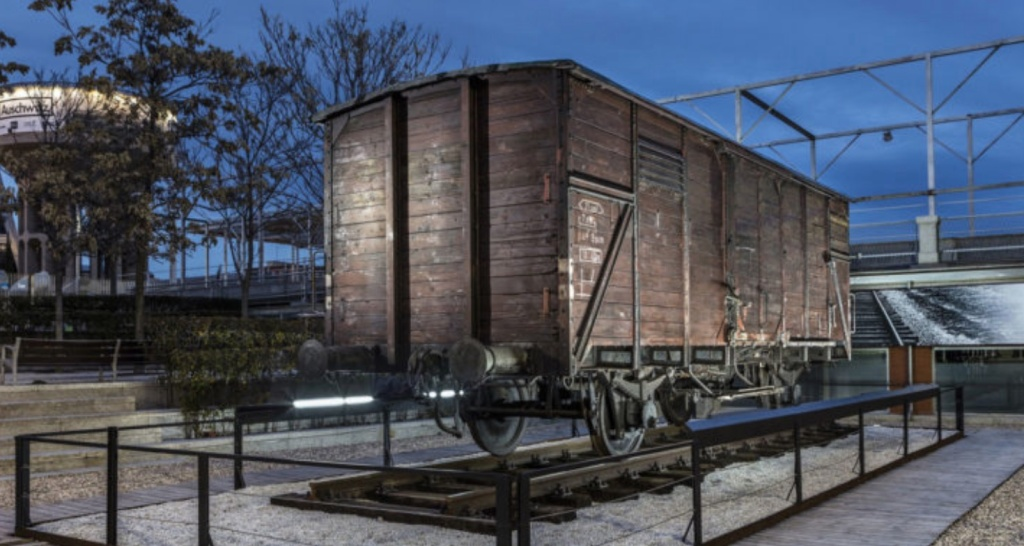 An original German freight train car used to transport Jews to concentration camps is included in