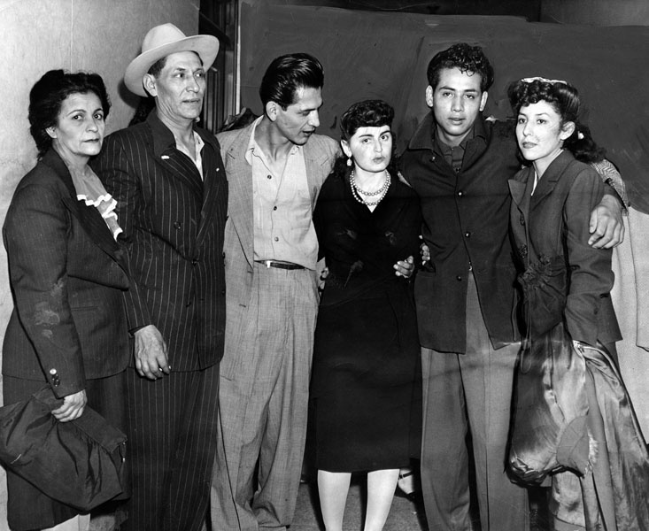 "Henry Leyvas, 21, and Gus Zammora, 22, two of the eight youths who were released from the County Jail, Monday, October 29, 1944 with all charges dismissed, after serving two years on conviction in the ""Sleepy Lagoon"" murder, are shown as they were greeted by relatives and friends. Left to right, Mrs. Lupe Leyvas, Seferino Leyvas, Henry Leyvas, Alice Greenfield, Gus Zammora and Ruth Amparay."