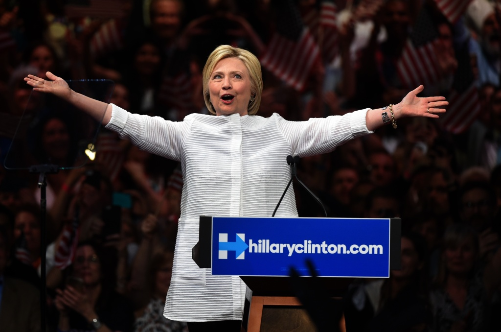 Democratic presidential candidate Hillary Clinton acknowledges celebratory cheers from the crowd during her primary night event at the Duggal Greenhouse, Brooklyn Navy Yard, June 7, 2016 in New York.